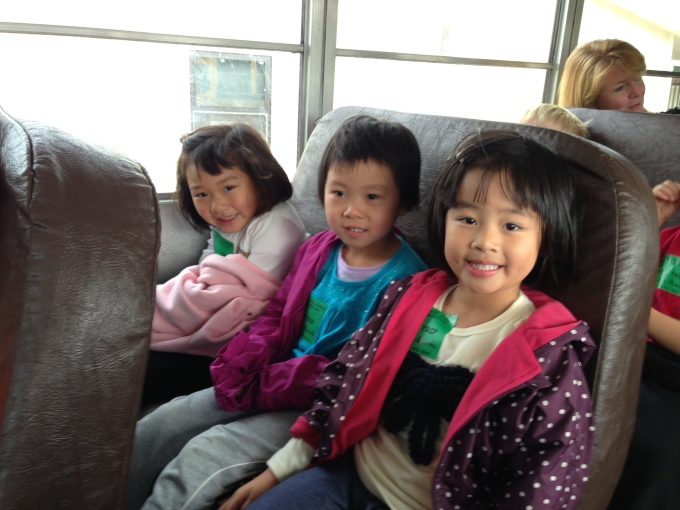 The girls with their classmate Carina on the school bus