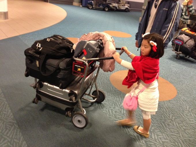 Our little helper. She's a savvy traveler by now and knows just what to do to help mommy and daddy!