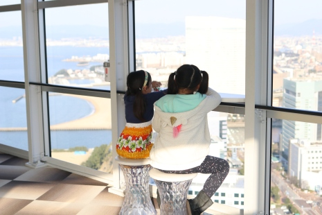 Admiring the beautiful view of Fukuoka from high up